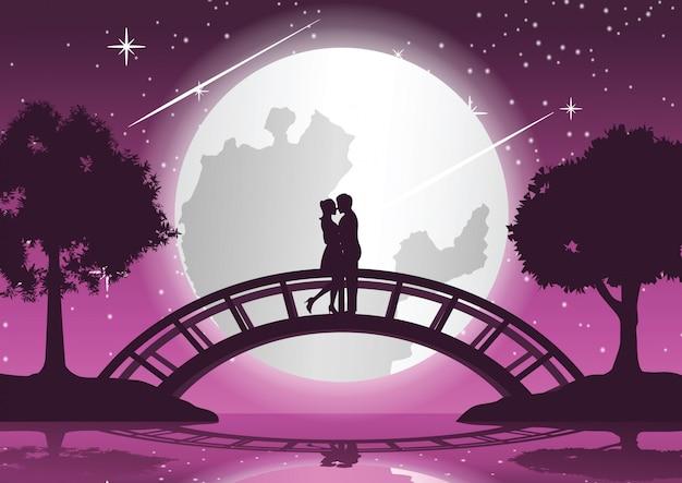 カップルが一緒に抱擁し、橋の上でキスします。