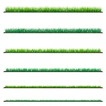 白で隔離され、緑の草のセット