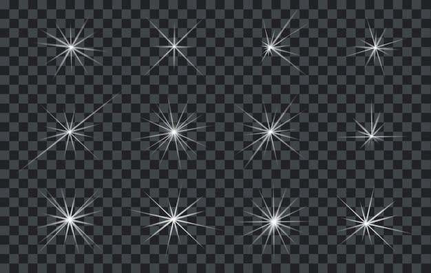 フレアまたは透明な背景を持つ星を輝く抽象的な照明のセット