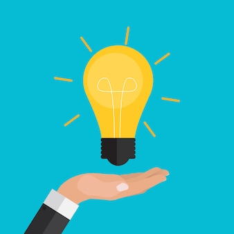 手はお金と電球を保持しています。イノベーションへの投資。モダンなフラットデザインのグラフィック。