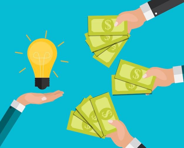 手はお金と電球を保持しています。イノベーションコンセプトへの投資。