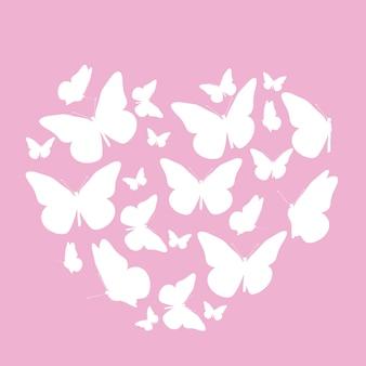 蝶から作られたハートマークと抽象的な背景。