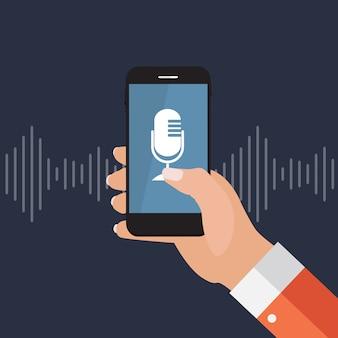 マイクボタンとフラットスタイルのインテリジェントな技術を持つ携帯電話を持つ手