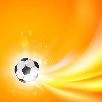 オレンジ色の背景に輝くサッカーボール