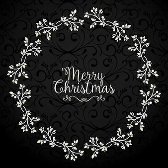 クリスマスのための花の花輪と暗い背景