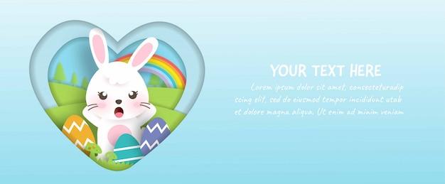 ペーパーカットとクラフトスタイルのかわいいウサギとイースターエッグのイースターバナー。
