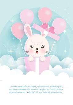 Поздравительные открытки дня рождения с кроликом, стоящим в подарочных коробках в бумажном стиле сокращения.