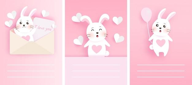 Набор милых карточек с белыми кроликами в стиле вырезки из бумаги