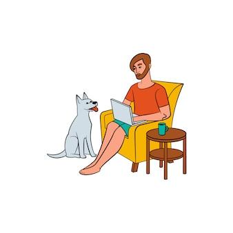 Молодой человек, фрилансер, работающий на дому и собака