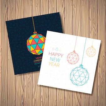 Стилизованные новогодние шары с рисунком из треугольников, деревьев, звезд