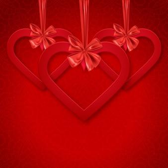 赤いハートと装飾的なリボンの弓で幸せなバレンタインデーの装飾的なはがきバナー