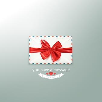 装飾的な赤い弓と現実的な白いビンテージ封筒