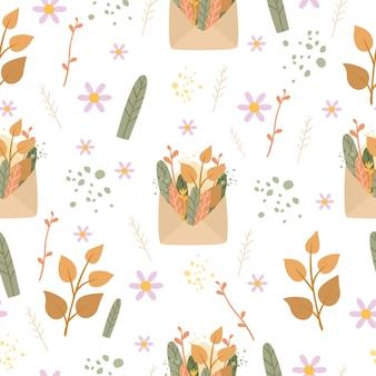 ロマンチックなシームレスパターンの封筒と植物