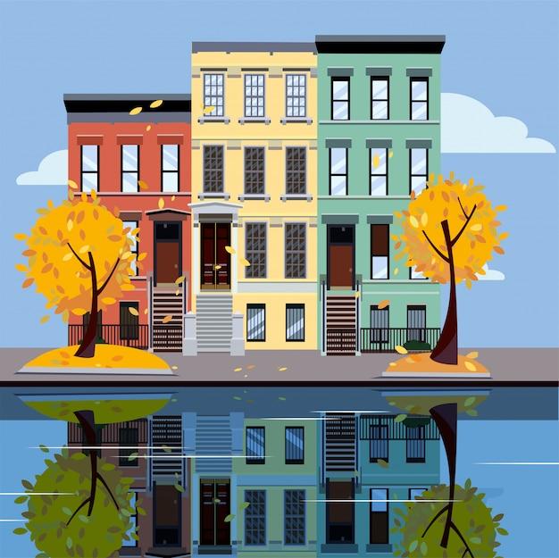 Жилые дома на озере. яркие фасады зданий. осенний город. улица городской пейзаж.