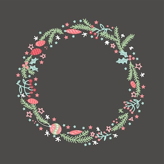 赤い果実とモミの枝と手描きの花輪。クリスマスカードと冬のラウンドフレーム。