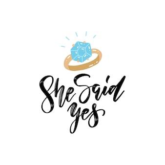 Она сказала «да» - рукописные надписи кистью. свадебный знак с бриллиантовым кольцом