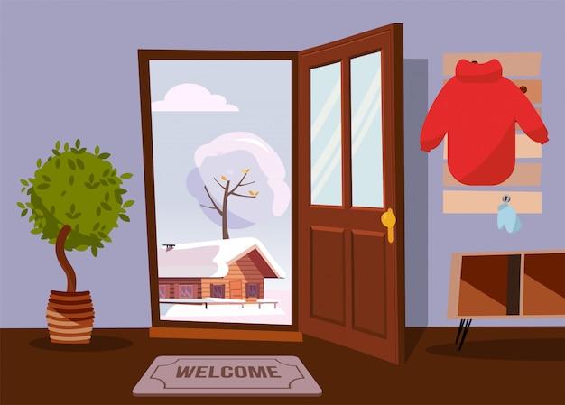 Интерьер прихожей с открытой дверью с видом на зимний пейзаж со старым домом