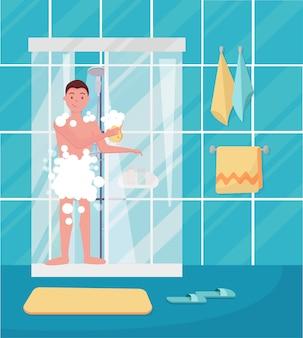 Молодой человек принимает душ.