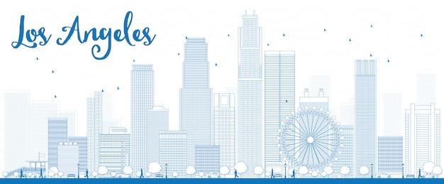 青い建物とロサンゼルスのスカイラインの概要を説明します。