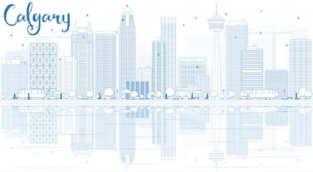青い建物と反射でカルガリーのスカイラインを概説します。