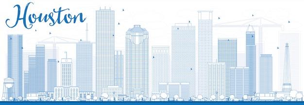 青い建物とヒューストンのスカイラインの概要を説明します。