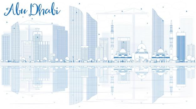 青い建物と反射とアブダビ市のスカイラインの概要を説明します。