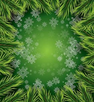Новогодний фон с белыми снежинками и сосновые ветви.