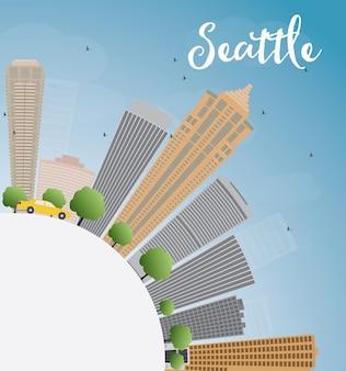 灰色の建物、青い空とコピースペースを持つシアトル市のスカイライン