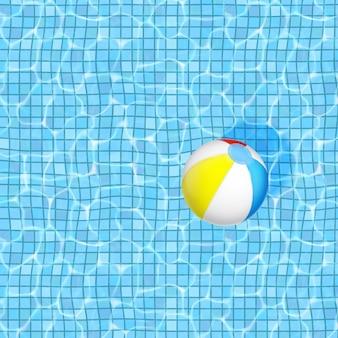 Вода в бассейне и надувной мяч