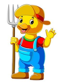 熊手を保持している漫画農家アヒル