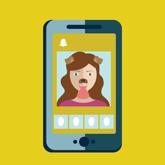 女の子がスナップチャット、電話アプリ、スナップチャットで犬のフィルターで写真を撮る