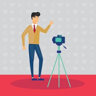 インターネットでそれを共有するためにビデオを録画するカメラの前の男。ビデオブログ