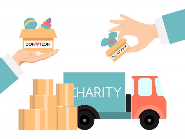チャリティートラックの寄付は寄付品の箱でいっぱい