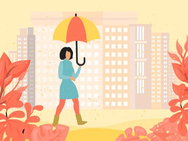 傘を持つ秋の紅葉公園の女の子。秋の庭の傘の下で屋外の女性。コートで落ちた雨の中を歩く女性