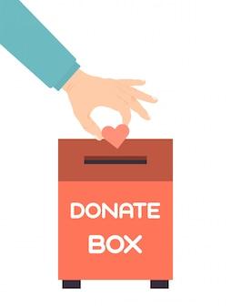 Рука положила сердце в ящик для пожертвований. ящики для пожертвований с сердечной иллюстрацией