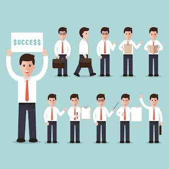 「成功」の符号を持つビジネスマン