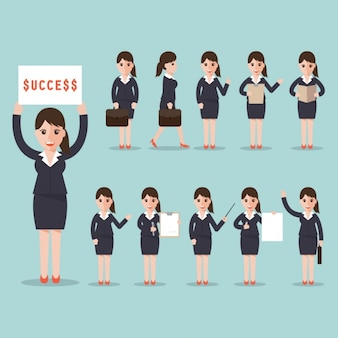 「成功」の符号を持つビジネスウーマン