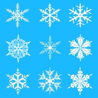 ベクトルの雪片が設定されます。クリスマスと新年のデザインのためのエレガントな雪片。