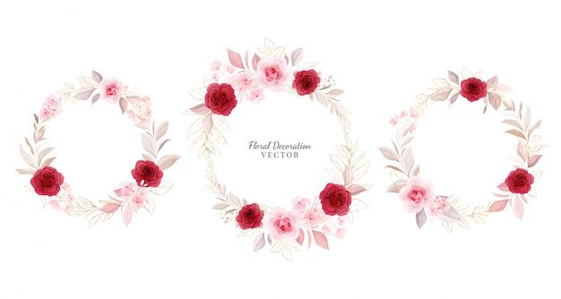 フローラルリースセット。金の葉、枝と赤と桃のバラの花輪の配置図。