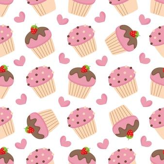ピンクのマフィンとかわいいのシームレスパターン。