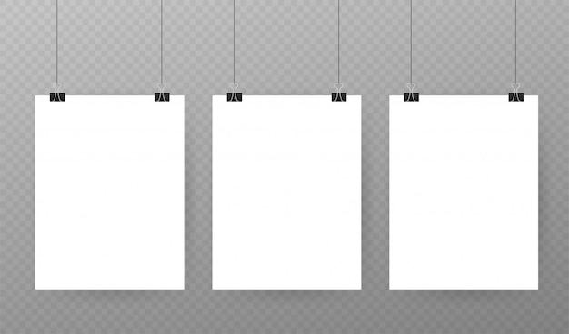 Набор разноцветных переплетных клипс на листе бумаги на прозрачном