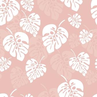 白いモンスターのヤシの夏のシームレスなパターンは、ピンクの背景に葉