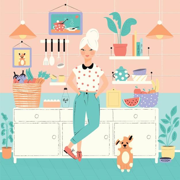彼女の台所で食べ物と犬の女性