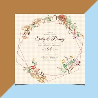 幾何学的な花の水彩画とビンテージのウェディング招待状