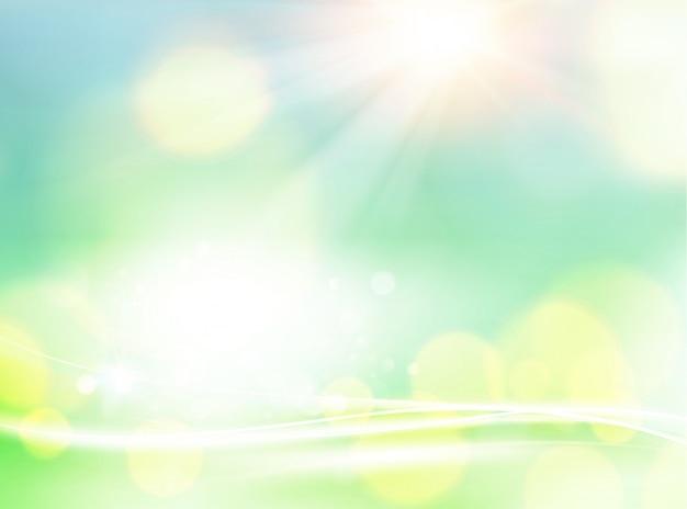 緑のボケ味の抽象的な光の背景。