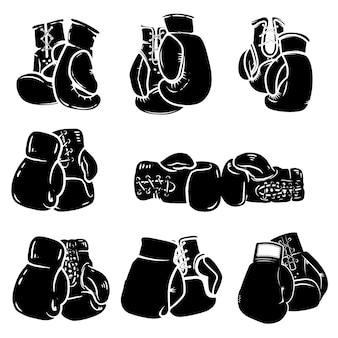 白い背景の上のボクシンググローブのセット。ポスター、エンブレム、看板、バッジの要素。図