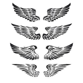 白い背景の上のヴィンテージの翼のセットです。ロゴ、ラベル、エンブレム、記号、ブランドマークの要素。