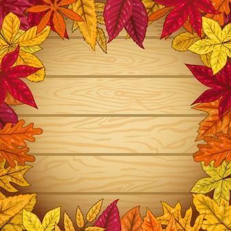 木製の背景に紅葉からの境界線。ポスター、カードの要素。図