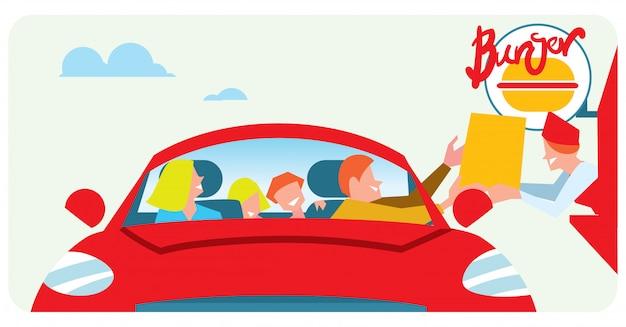 車からファーストフードを注文する家族