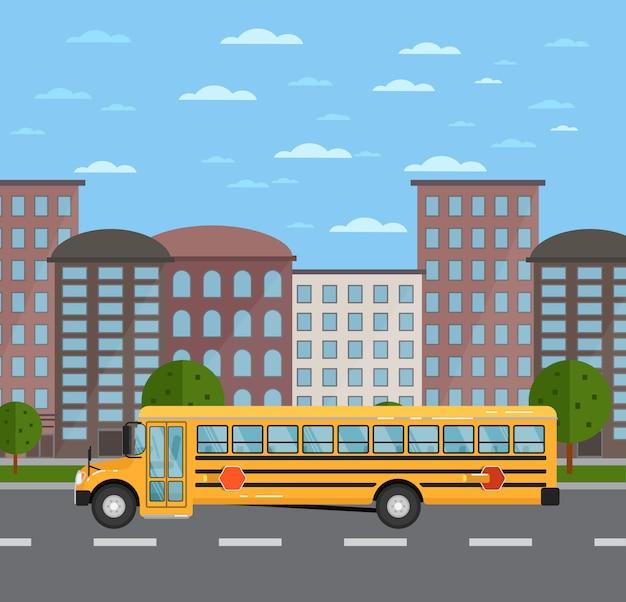 都市景観における道路上の黄色のスクールバス